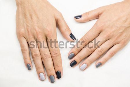 Female hands with a stylish neutral manicure Stock photo © bezikus
