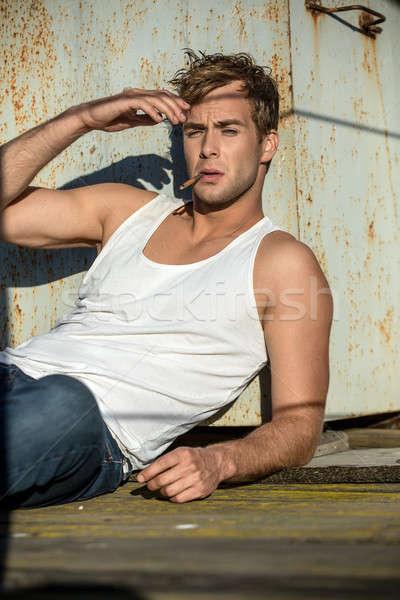 Brutal guy with cigarette Stock photo © bezikus