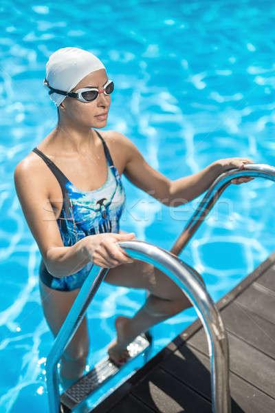 少女 泳ぐ プール かなり はしご スイミングプール ストックフォト © bezikus