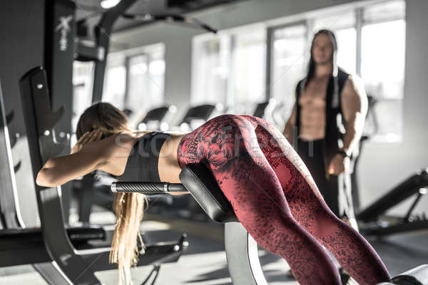 Athletic girl in gym Stock photo © bezikus