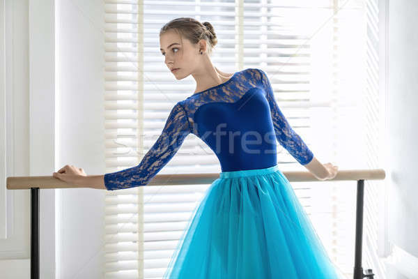 Ballerina is training on barre Stock photo © bezikus