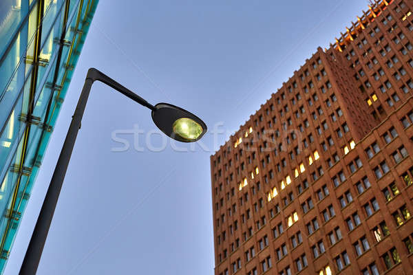 Facades of luminous buildings Stock photo © bezikus