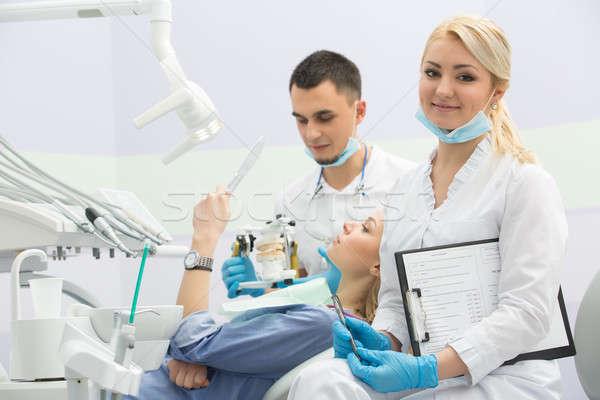 Modern fogászati klinika fiatal fogorvos dolgozik Stock fotó © bezikus