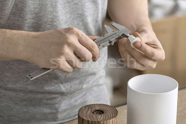 Man using caliper in workshop Stock photo © bezikus