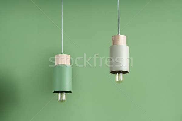 Hanging metal colorful edison lamps with wooden parts Stock photo © bezikus