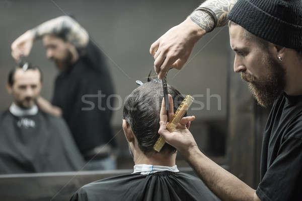 Doing haircut in barbershop Stock photo © bezikus