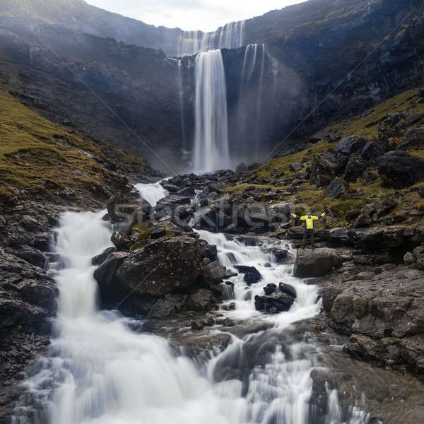 Beautiful waterfall falls down from the rocky cliff on Faroe Isl Stock photo © bezikus