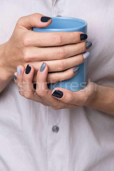 Női kezek kék csésze gyönyörű elegáns Stock fotó © bezikus