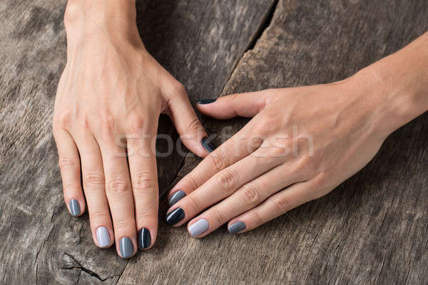 Beautiful hands with the miniature painted in a gray-colored  Stock photo © bezikus
