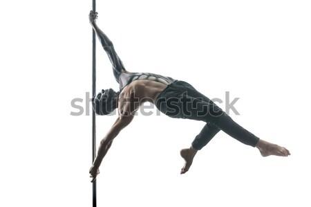 Posing of pole dance couple in studio Stock photo © bezikus