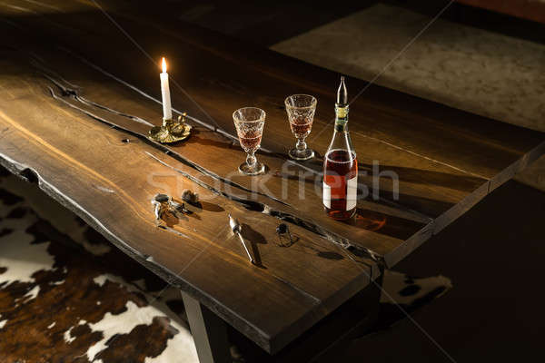 Bottle with glasses and accessories on table Stock photo © bezikus