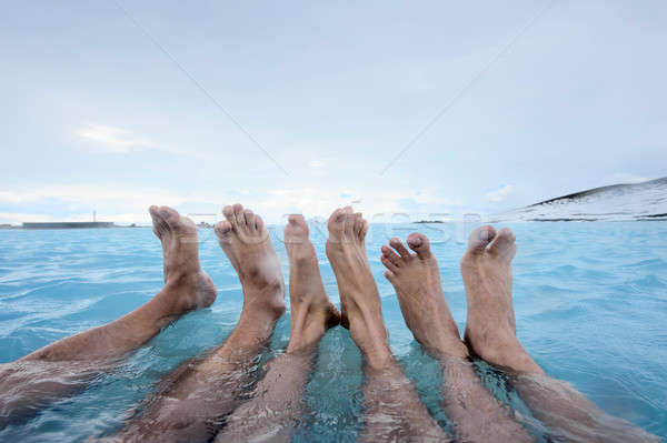 People relaxing in geothermal pool outdoors Stock photo © bezikus