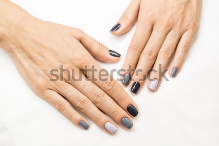 Hand with a stylish gray manicure isolated on white background Stock photo © bezikus