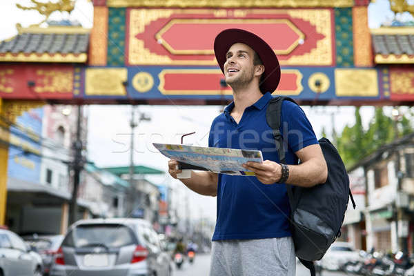 Traveler on asian city street. Daylight shooting. Stock photo © bezikus