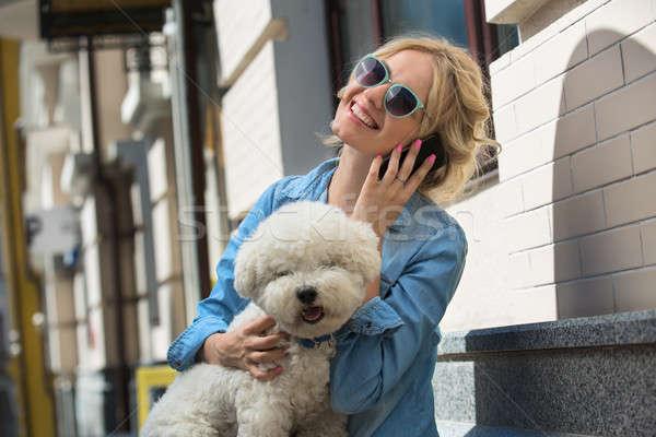 Cute blonde with Bichon Frise white dog Stock photo © bezikus