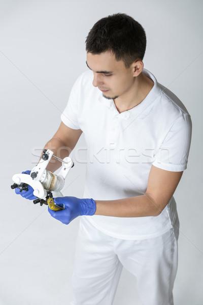 Dentist with parallelometer Stock photo © bezikus