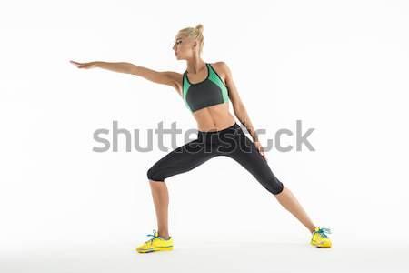девушки студию блондинка спортивная одежда белый кроссовки Сток-фото © bezikus
