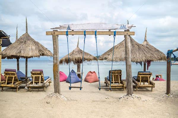ビーチ スイング 木製 海 曇った 空 ストックフォト © bezikus