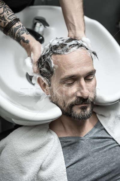 Stock photo: Washing head in barbershop