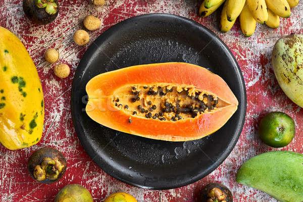 Színes egzotikus gyümölcs különböző rongyos fából készült Stock fotó © bezikus