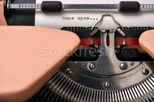 Vintage typewriter coral color in studio, close up. Stock photo © bezikus