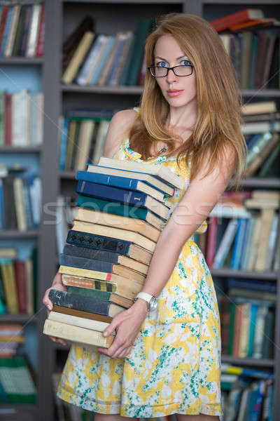Blue-eyed girl with red hair in the library Stock photo © bezikus
