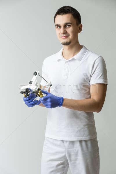 Dentista sorridente médico branco uniforme azul Foto stock © bezikus