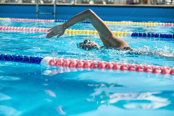 Swimmer in the swim pool Stock photo © bezikus