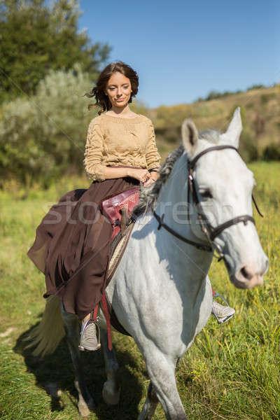 Stock photo: Beautiful girl riding a white horse