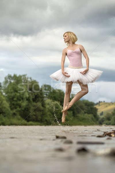 Ballerina jumping above river Stock photo © bezikus