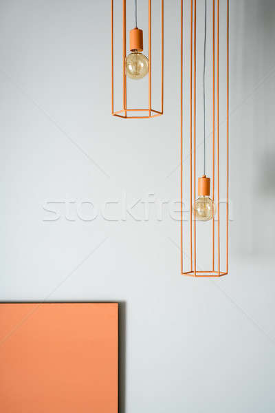 Suspendu orange lampes paire métallique ampoules Photo stock © bezikus