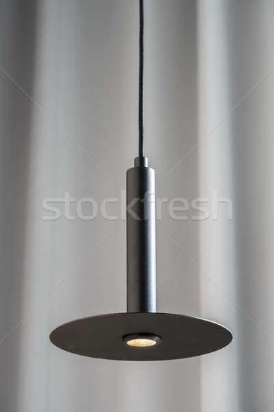 Fekete fémes lámpa akasztás szürke függöny Stock fotó © bezikus