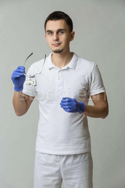Doctor with binocular loupes Stock photo © bezikus