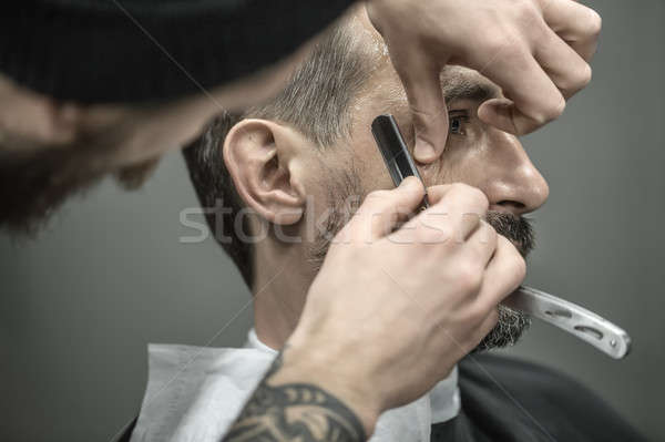 Stock photo: Trimming hair in barbershop
