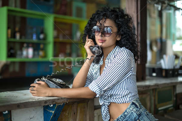 Stock photo: Girl is talking on phone