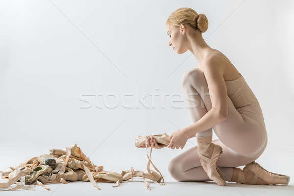 Ballerina with many pointe shoes Stock photo © bezikus