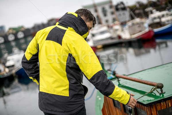 Man standing in dock Stock photo © bezikus