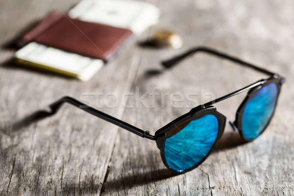Stylish sunglasses with blue tinted mirror on textured wooden ba Stock photo © bezikus