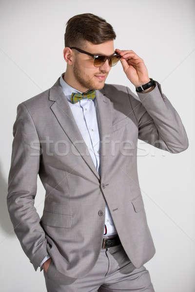 Stock fotó: Vonzó · férfi · öltöny · nyakkendő · pillangó · ruha