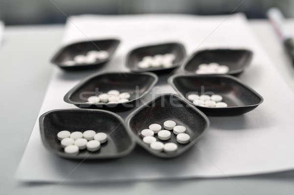 Small bowls with pills Stock photo © bezikus