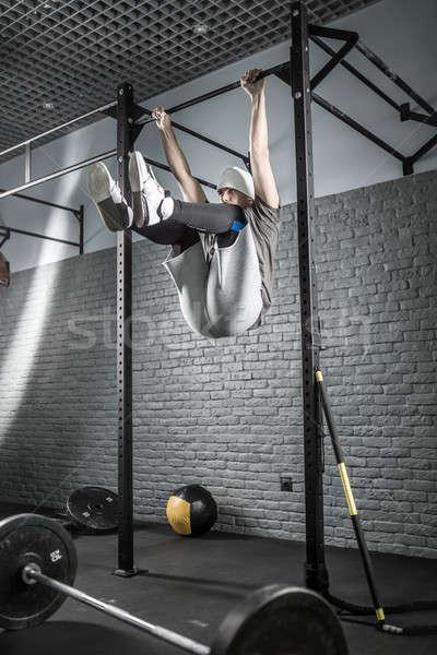 Strong man pull-up workout Stock photo © bezikus