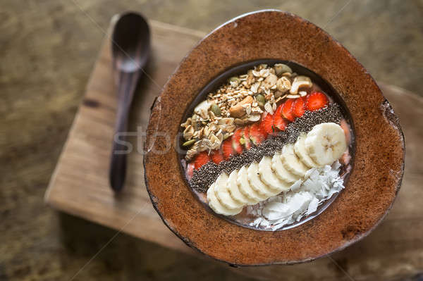 Gyümölcs mix kókusz tányér fél kanál fa deszka Stock fotó © bezikus