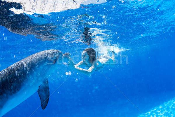 Golfinhos menina água olhos cabelo beijo Foto stock © bezikus