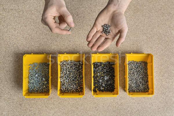 Plastica scatole maschio mani quattro giallo Foto d'archivio © bezikus