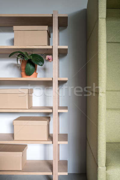 Stylish interior with wooden shelves and gray walls Stock photo © bezikus