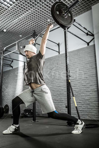 Man's crossfit workout with barbell Stock photo © bezikus