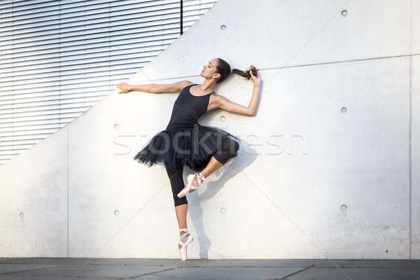 Attractive ballerina posing outdoors Stock photo © bezikus