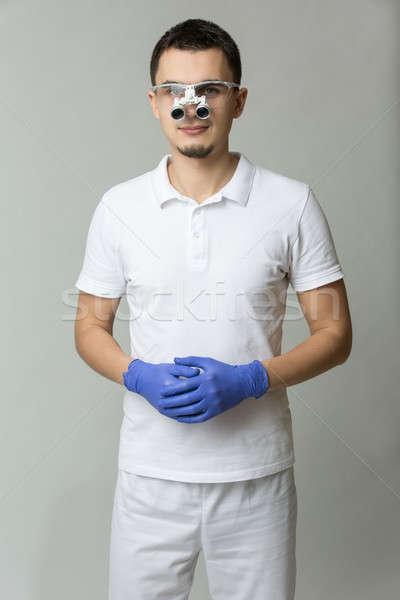 Dentist with binocular loupes Stock photo © bezikus