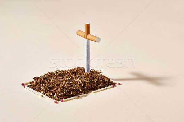 Tobacco grave with cigarette cross Stock photo © bezikus