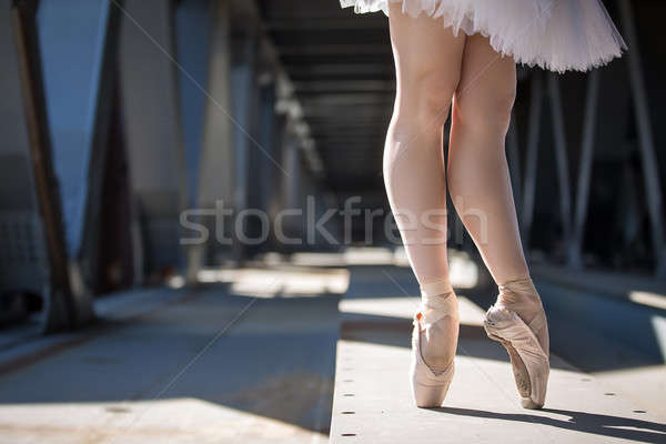 Cropped picture legs of graceful ballerina in white tutu Stock photo © bezikus